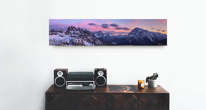 A panoramic canvas print displayed over a credenza.